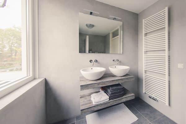 stucstunter beton cire badkamer vloer wand