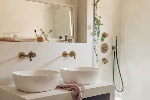 stucstunter beton cire badkamer